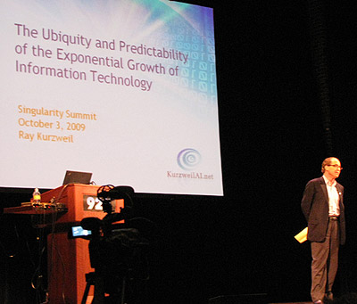 Ray Kurzweil on the stage at the 2009 Singularity Summit